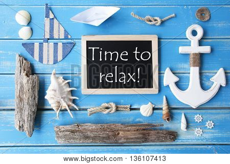 Flat Lay Of Chalkboard On Blue Wooden Background. Sunny Nautic Or Maritime Summer Decoration As Holiday Greeting Card. English Text Time To Relax