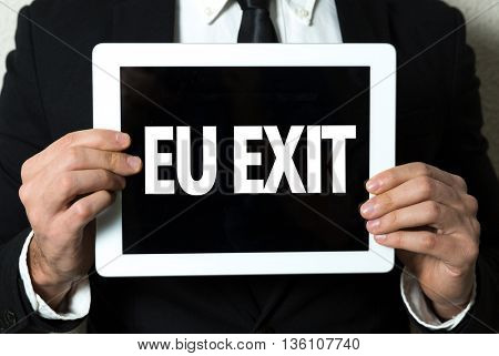Business man holding a tablet with the text: EU Exit