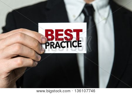 Business man holding a card with the text: Best Practice