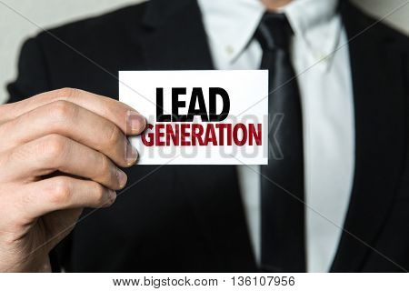 Business man holding a card with the text: Lead Generation