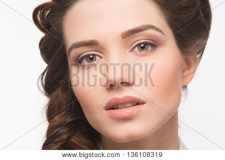 Hairstyle. Beauty glamour fashion model girl portrait. Perfect skin and makeup. Closeup portrait of half face of woman in studio. Lady with creative braid hairstyle.