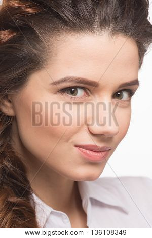 Closeup portrait of beautiful woman smiling while demonstrating modern hairstyle in studio. Hair braid. Beautiful woman with healthy long hair. Hairdressing. Hairstyle.