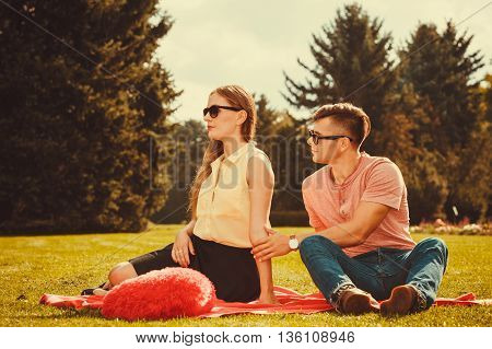 Moody Girl With Boyfriend In Park.