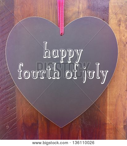 Happy Fourth Of July Greeting On Heart Shape Blackboard
