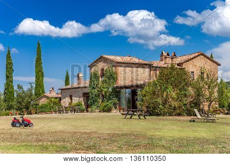 Big brick house in the countryside of Tuscany Italy. Rural landscape. Rest zone.