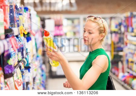 Beautiful caucasian woman shopping cleaners at supermarket.