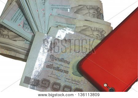 Money thai baht and red smartphone .