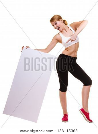 Fitness and health lifestyle advertisement. Young woman girl holding presenting pointing blank empty banner ad copyspace isolated on white background.