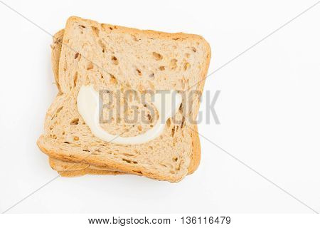 Sweetened condensed milk at Bread on white background