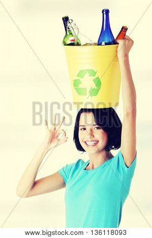 Beautiful woman holding recycling basket