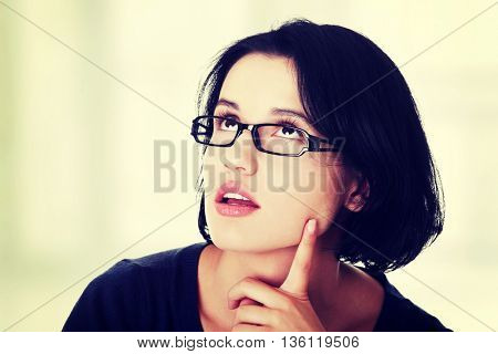Young beautiful woman in casual clothes thinking