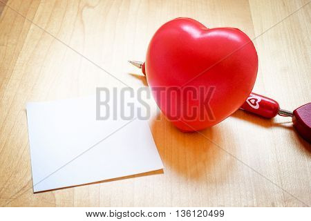 Notepad With Heart Toy And Red Pen On Wooden Table,love Concept