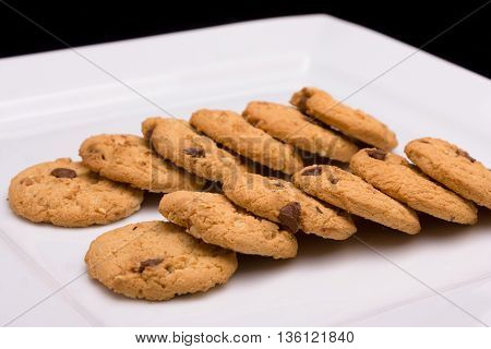 Two rows of cookies laid out on a plate
