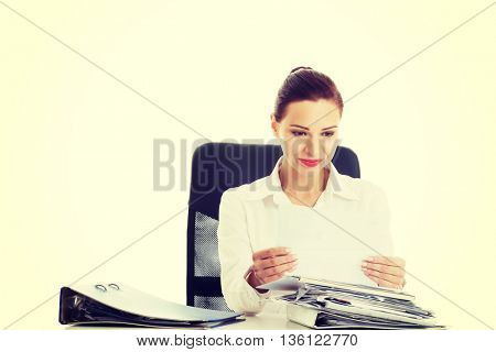 Beautiful business woman sitting by a desk.