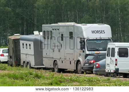 Tyumen, Russia - June 24, 2016: The 5th open championship of Russia on a plowed land. Horse van for animal transportation at hippodrome