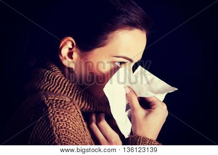 Sad young girl with tissue.