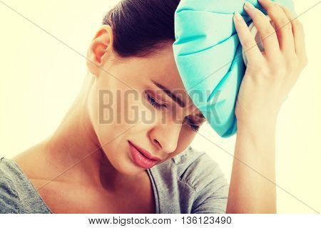 Young beautiful woman is haveng a headache.