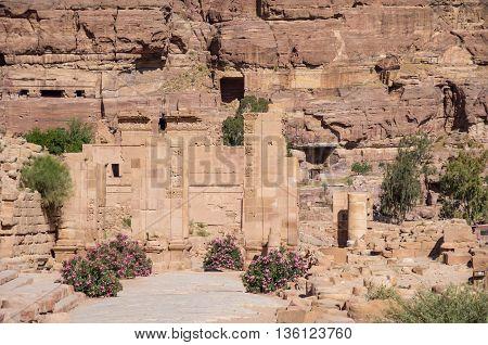 The Hadrian (temenos) Gate And The Cardo Maximus In Petra. Qasr Al-bint At Background. Petra, Jordan