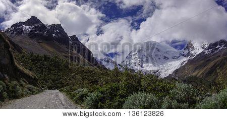Mountain pass in Huascaran National Park with Huascaran mount at background. Cordillera Blanca. Peru.