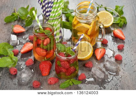 Cold fruit tea on a wooden background