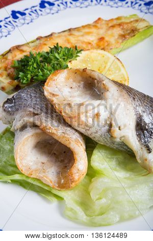 Grilled dorado fish fillet with fried vegetables