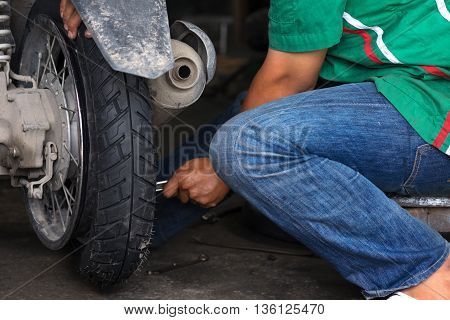 Motorbike tire replacement scene, installation in garage