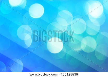 Blurred blue bokeh abstract background for design