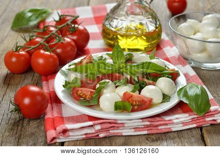 Italian caprese salad on a wooden background