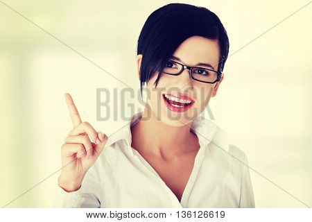 Beautiful business woman showing copy space