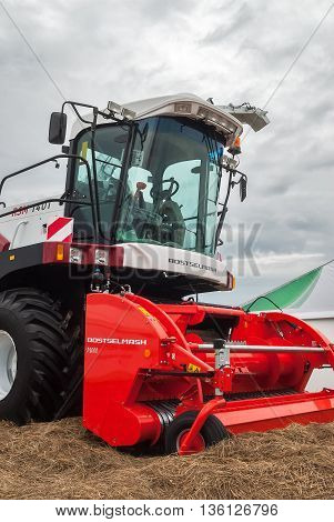 Tyumen, Russia - June 24, 2016: The 5th open championship of Russia on a plowed land. Contemporary harvester standing on demonstration platform for sale