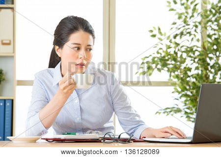 Young Asian Business Woman Overworked With Uncomfortable