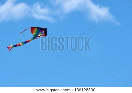 colorful kite flying high in the sky blue