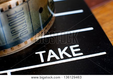 Take Label On Movie Clapper And Film Reel