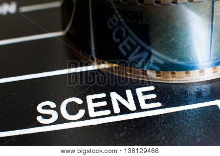 Scene Label On Movie Clapper And Film Reel