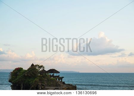 Tanah lot temple on cliff in Bali island