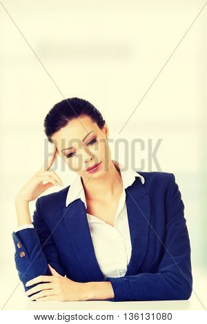 Sad businesswoman sitting behind the desk
