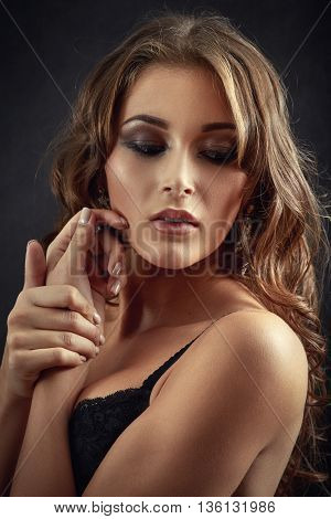 beautiful woman in lingerie on black background toned image