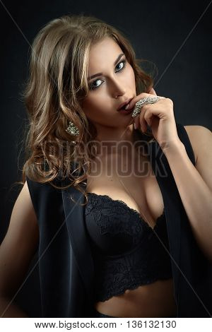pretty woman in lingerie undressing toned image