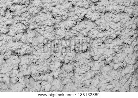 rough texture of bumpy plaster of gray color for an abstract background or for wallpaper of monochrome tone