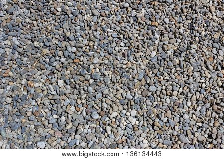 Small stones gravel texture. Naturally pebble textured background.