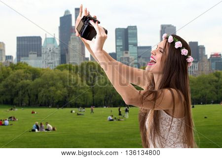 Young brunette girl taking selfie photo in Central Park, NYC