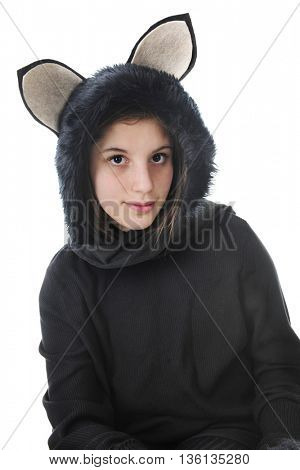 Close-up image of an attractive young teen dressed as a furry black cat.  On a white background.