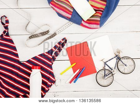 Bicycle Model, Striped Backpack, Swimsuit, Notepad, Sunscreen, Bottle Of Water And Centimeter Tape O