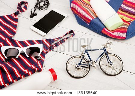 Bicycle Model, Striped Backpack, Swimsuit, Smart Phone, Headphoned, Sunglasses, Sunscreen, Bottle Of