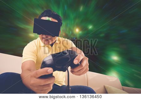 Man in VR glasses playing space simulation game