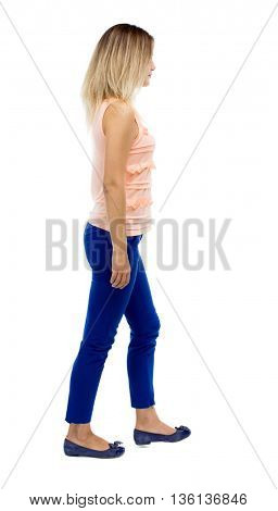back view of walking  woman. beautiful blonde girl in motion.  backside view of person.  Rear view people collection. Isolated over white background. The blonde in a pink blouse is in the side.