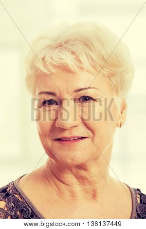 Portrait of an old, elderly lady.