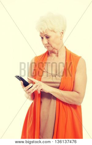 An old lady using mobile phone.