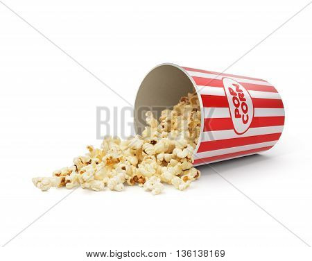 Popcorn in striped bucket on white background