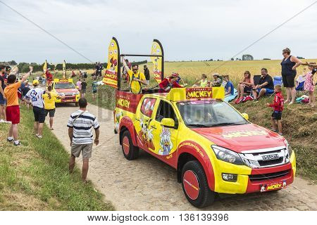 Quievy, France - July 07 2015: Le Journal de Mickey caravan during the passing of the Publicity Caravan on a cobblestoned road in the stage 4 of Le Tour de France on July 7 2015 in Quievy France.
